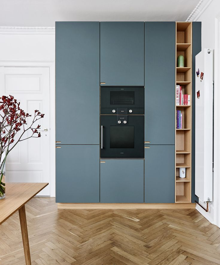 The high cabinets along the wall ensure the best use of vertical space.