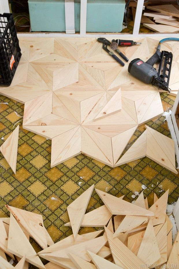 Mandi from 'Vintage Revivals' created this DIY geometric wood floor project for a trailer remodel, but there is no reason you can't use it in your home. This project would be best for a small space, as it is more intricate, but that's the charm of it! Just in case you're interested, this is from a series where they DIY remodeled a 1972 travel trailer… ever thought of picking one up for the fam, but couldn't stand the outdated decor? Check out her series!
