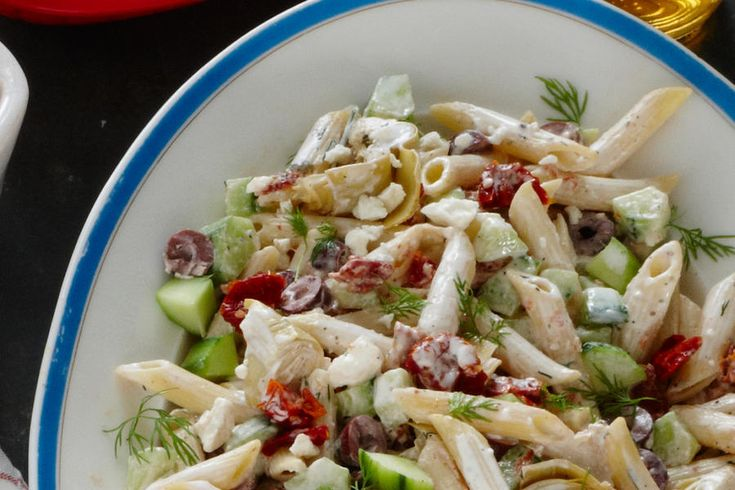 """Winner: Best Pasta Salad - BBQ Side Dish Smackdown - Southernliving. Dawn Moore from Warren, Pennsylvania  """"I merged my love of Greek ingredients with my favorite barbecue side dish: pasta salad. It's wonderful with grilled chicken.""""  Recipe:Tangy Tzatziki Pasta Salad"""