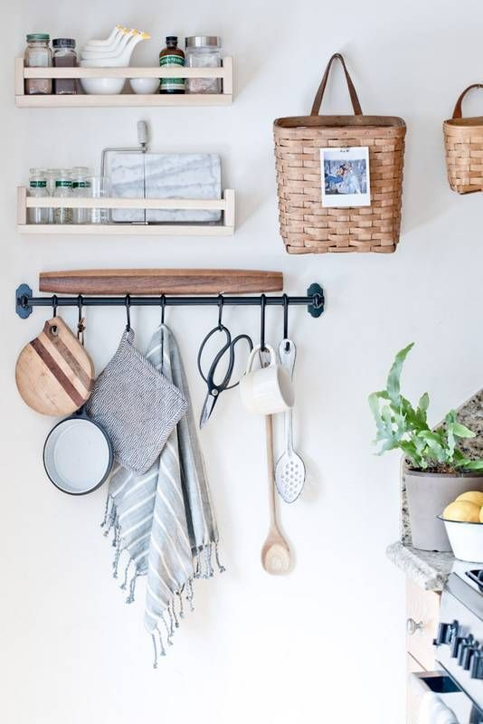 go vertical. Like The use of spice racks and hanging rod for measuring cups, measuring spoons, etc