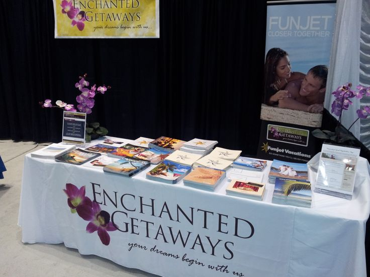 enchanted getaways minneapolis wedding expo booth before the show our evenly stacked brochure piles