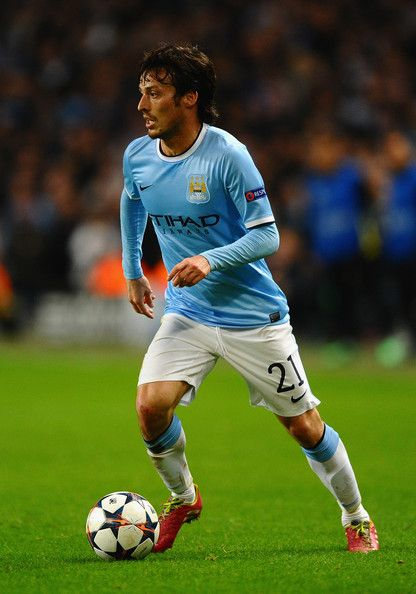 David Silva of Manchester City in action during the UEFA Champions League Round of 16 first leg match between Manchester City and Barcelona at the Etihad Stadium on February 18, 2014 in Manchester, England.