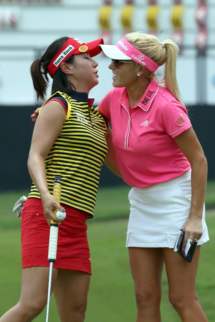 Natalie Gulbis Photos - Park Hee Young of South Korea hugs Natalie Gulbis of USA on the 8th hole during the Sime Darby LPGA at Kuala Lumpur Golf & Country Club on October 9, 2014 in Kuala Lumpur, Malaysia. - Sime Darby LPGA: Day 1