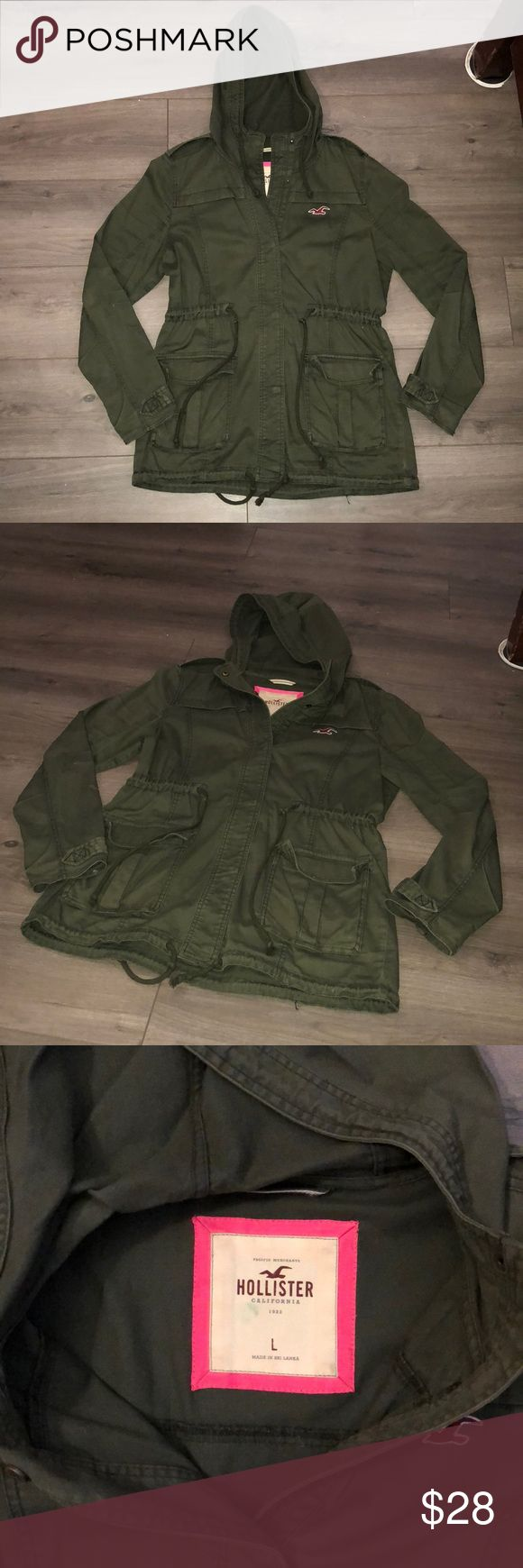 HOLLISTER ANORAK PARKA JACKET HOLLISTER parka/cargo jacket. Used good condition. Olive green size large. The waist area has strings that can be tightened or loosened. Lightweight. Hollister Jackets & Coats Utility Jackets