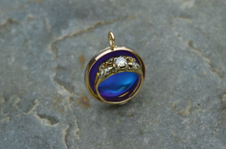 https://flic.kr/p/f83TCZ   Cheryl's Pendent   This is a set of Wedding Rings that I made into a Pendent for Cheryl. Her mother's wedding ring is now connected to her father's wedding band. Niobium (blue)  high-lights the piece.