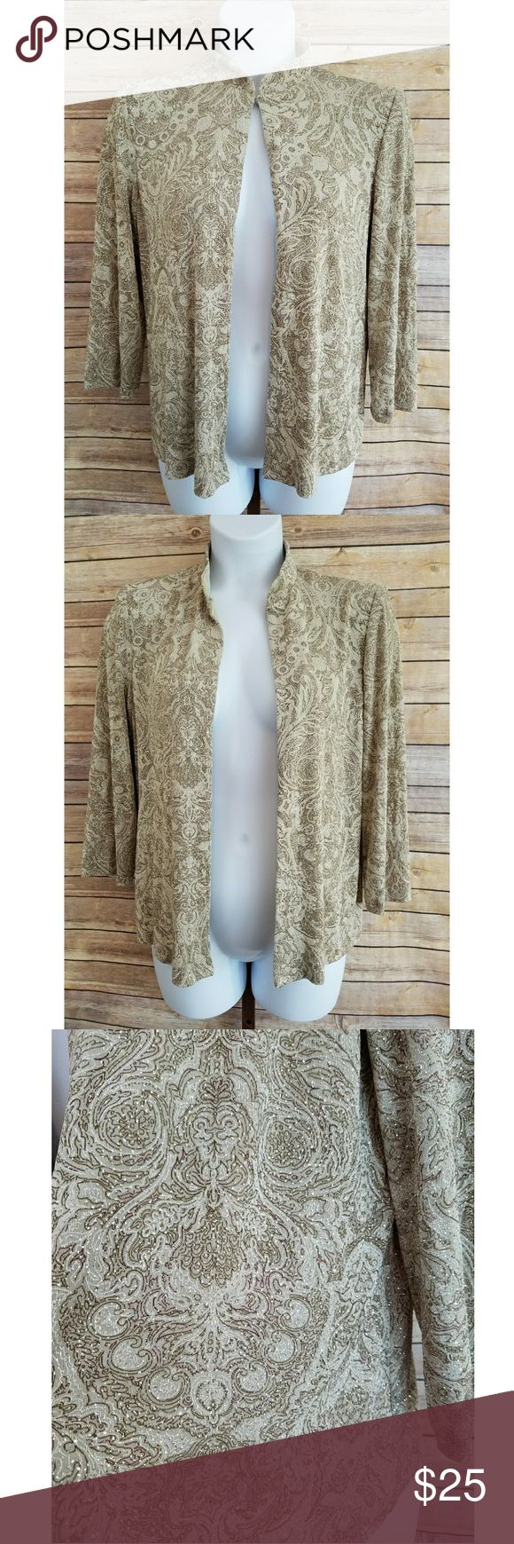 "Alex Evenings Womens Large Dressy Glitter Jacket Stunning and sparkling womens special occasion jacket from Alex Evenings! Womens size Large. Measures approximately 26"" long from shoulder and 22"" from armpit to armpit. This open jacket has shoulder pads for an elegant look. Closes at neck only. Champagne beige fabric with gold all-over glitter design. (Inside label reads this was part of a 2-piece outfit, but this listing is only for the single open jacket piece).  In excellent pre-owned…"