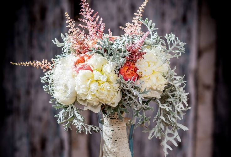 Peony & dusty miller bridal bouquete. Some vuvuzelas between.