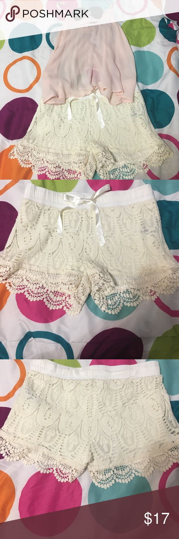 Cream Lace Shorts Rarely used lace shorts. These run small so they're really tight instead of a medium it's like a small. Price is negotiable and I'm willing to sell outside of Posh. I'm also selling the shirt in another listing if interested. T.J.Maxx Shorts