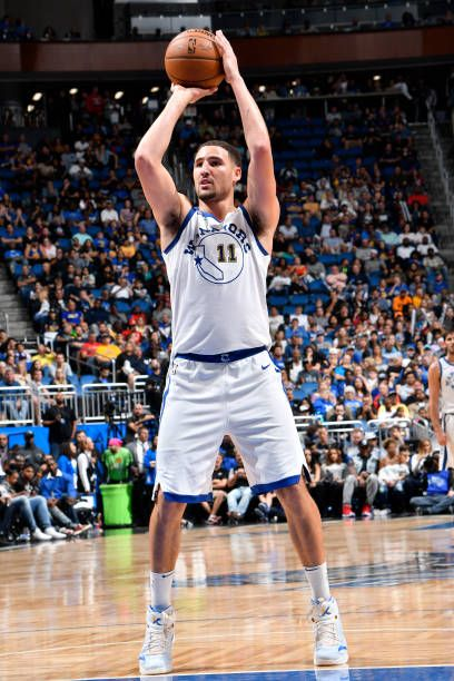 Klay Thompson of the Golden State Warriors shoots the ball against the Orlando Magic on December 1 2017 at Amway Center in Orlando Florida NOTE TO...