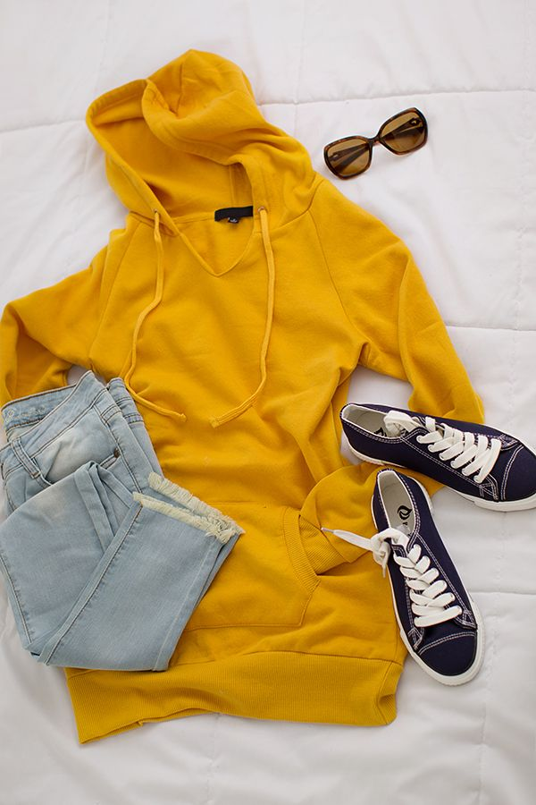 Women's fashion for the girl on the go! I will be wearing this pretty much every day this fall. Light wash denim, mustard hoodie and a messy bun. Yes, please!