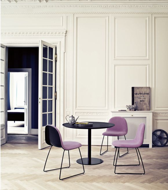 A Divine Dining Room. White walls, herringbone floors, and Gubi chairs with purple upholstery. http://cimmermann.co.uk/blog/dining-tables-favourites/