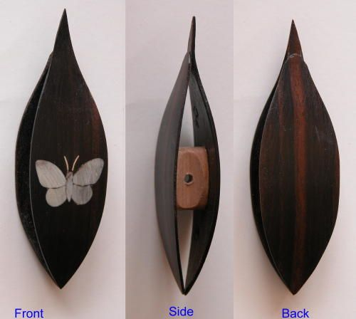 Ebony  shuttle with bone and silver butterfly inlay--really pretty.