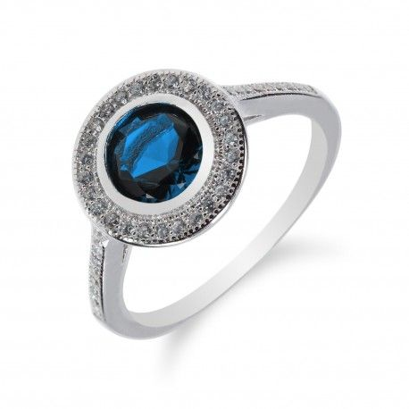Stříbrný prsten s kulatým safírem a zirkony