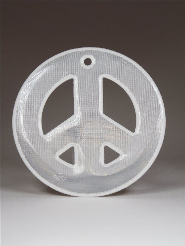 Peace and love soft white reflector. Comes with a blue ball chain.  Attach to bags, jackets or any other garments or equipment.   Approximately 85mm high and 40mm wide.   For maximum visibility place on the front, side or back of your body. Allow your reflector to move freely at knee length to catch the headlights of moving vehicles.