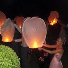 Eco Friendly Wedding Sky Lanterns... These things are lovely! No wire and a much better alternative to fireworks!
