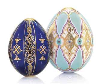 TWO PORCELAIN EGGS BY THE IMPERIAL PORCELAIN FACTORY, ST PETERSBURG, CIRCA 1840-1850. Each ovoid, one with cobalt blue body painted with alternating panels of ciselé gilt flowerheads and geometric ornament with white heightening, the other with pale turquoise body painted with vertical strapwork panels of ciselé gilt interlaced foliate motifs, both unmarked.