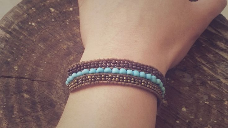 Excited to share the latest addition to my #etsy shop: Women Handmade Bracelet with Brown, Light Blue and Gold Beads. Leather 3 rows Bracelet. http://etsy.me/2CQCyS4 #jewellery #bracelet #beadedbracelet #beads #brownbracelet #leather #button #lightbluebeads #goldbeads