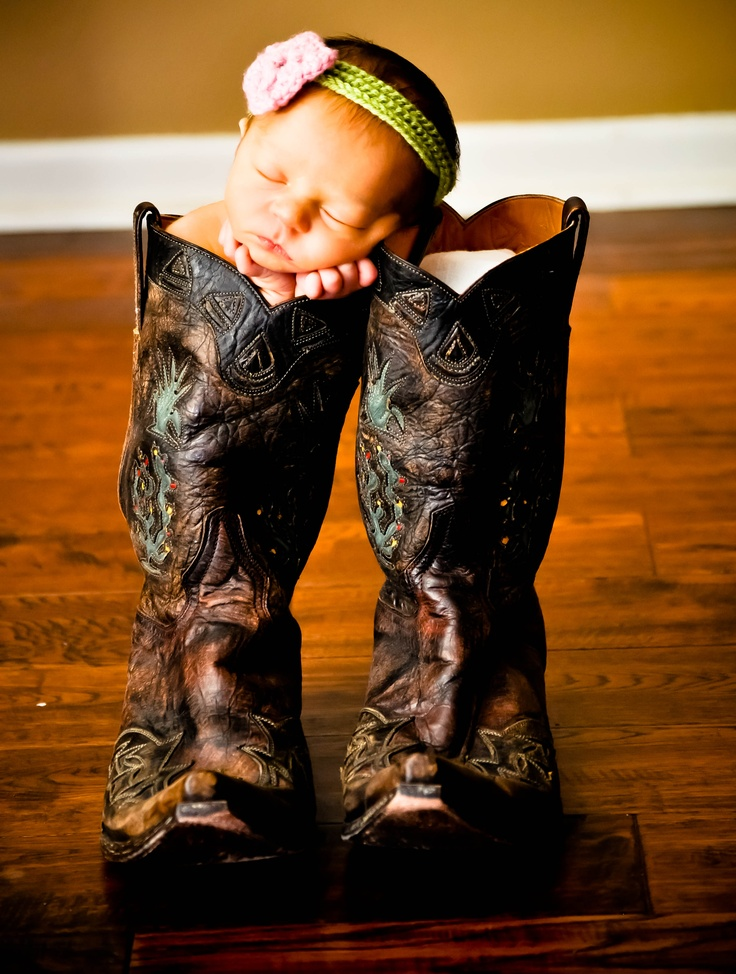 Sweet.. Baby girl and daddy's boots..Baby Boy