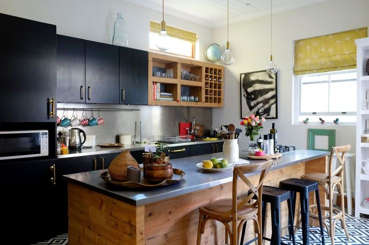 """Anne & Steve's Relaxed, Eclectic & Casual Home in Cape Town: """"We all enjoy having a sundowner on the deck followed by a cozy meal chatting round the kitchen island,"""" which features a petite stove."""
