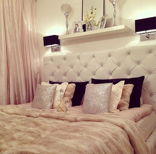 Beautiful, cozy, luxurious, glamorous, bed with couture pillows and bed frame