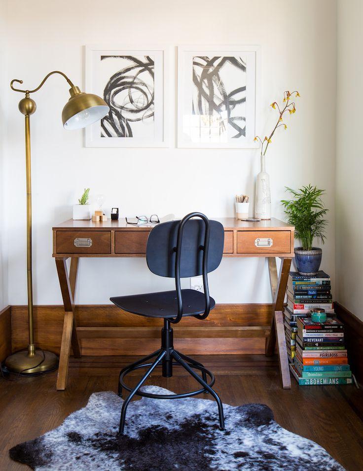 campaign desk, gold task lamp, cowhide rug