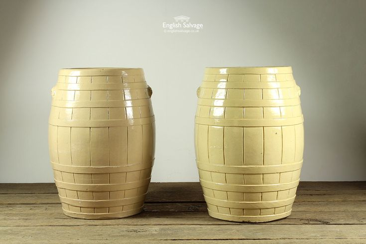 Antique cream glazed flour barrels pair, in the traditional coopered form, with small handles either side.