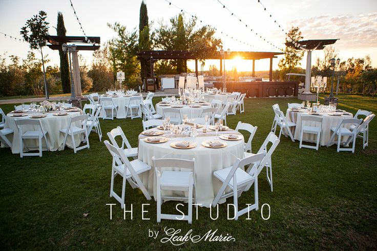 Beautiful shot of the outdoor reception venue at Mount Palomar Winery in Temecula. Photos by Leah Marie Photography - great shot showing off the classical statues and decor in this beautiful winery wedding. #mountpalomarwinery
