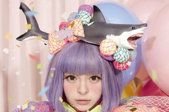 6. Occasionally she does opt for something a bit simpler, like a button-covered shark. | 10 Outfits That Reveal Kyary Pamyu Pamyu Is Still Just As Crazy As Lady Gaga