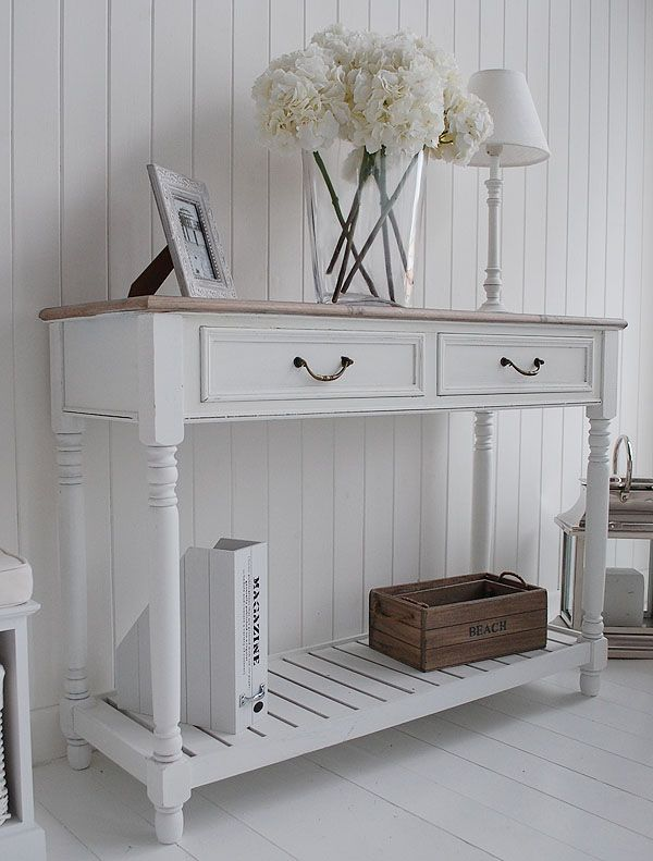 I like the slats on the base of this console table - gives a bit of beachy feel.