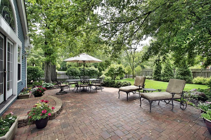 Huge brick patio with lounge chairs and dining area