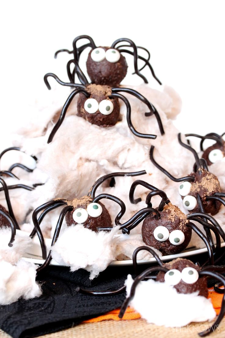 cotton candy makes for a great edible web for these creepy halloween chocolate spiders - Halloween Chocolate Spiders