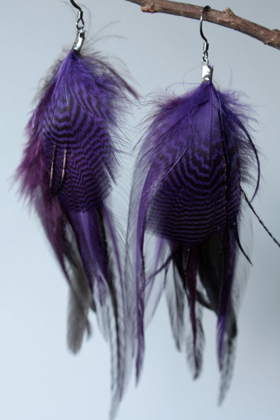 My friends Beautiful purple feather earrings click on the esty link below my name to see more