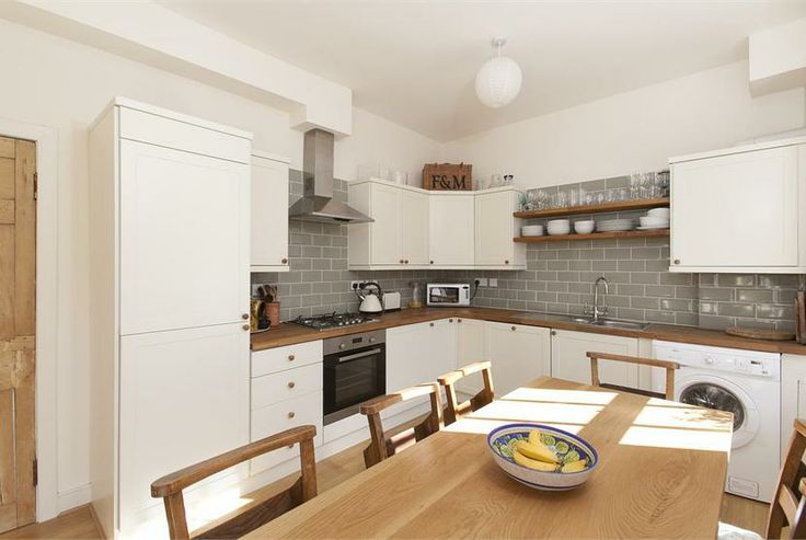 Northumberland Place flat - could use the same subway tiles as on the sitting room fire surround for a kitchen splasback?