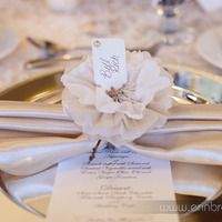 Paper flower cinching an ivory satin napkin tied around a gold charger. Perfect! Photo by www.erinbrooke.com.