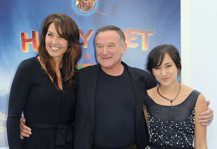 """Robin Williams, with his daughter, Zelda Williams, right, and third wifeSusan Schneiderarrive at the premiere of  """"Happy Feet Two"""" at Grauman's Chinese Theater in 2011. Photo: Katy Winn, Wire Photo / AP2011"""
