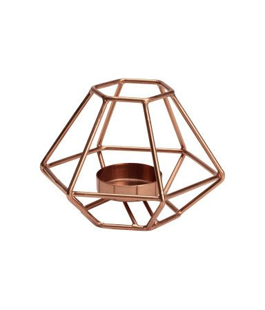 Copper-colored. Metal tea light holder. Height approx. 3 1/4 in., width 5 in.