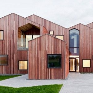CEBRA's children's home forms a cluster  of archetypal house silhouettes. The fragmented gables that make up this children's centre by Danish studio CEBRA feature matching dormer windows that in some places have been extruded, inverted or turned upside down.