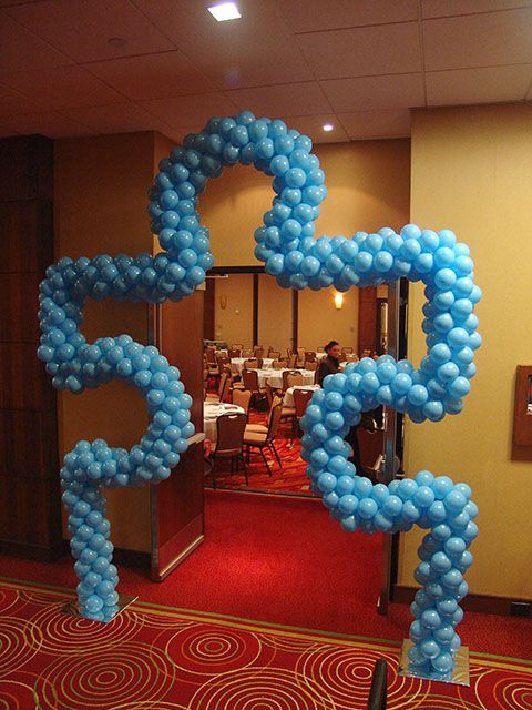 Autism Speaks. Maybe frame a turte or roman lamp and attach ballons