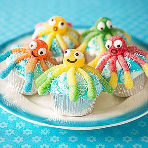Cute octopus cupcakes made from gummy worms and cup drops. Smiles made with Wilton's black food-writer and eyes made from Wilton candy eyes glued with icing.