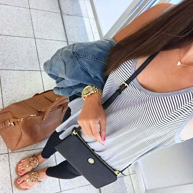 IG @mrscasual <click through to shop this look> Striped tank. Tory burch crossbody. Black Zella live in leggings. Miller sandals. Sole society carry on luggage tote. Denim jacket. Kendra scott.
