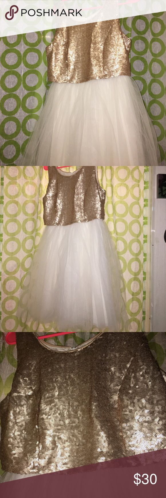 Gold Sequin and White Tool Homecoming/Party Dress Gorgeous White tool dress with a gold sequins top fit with thick straps. HAS BEEN ALTERED TO BE ABOUT A HALF INCH SHORTER THEN ORIGINAL! Worn once to a wedding. PRICE IS NEGOTIABLE IF THE PROCE DOSENT WORK FOR YOU LEAVE A SUGGESTION :) Emerald Sundae Dresses Mini