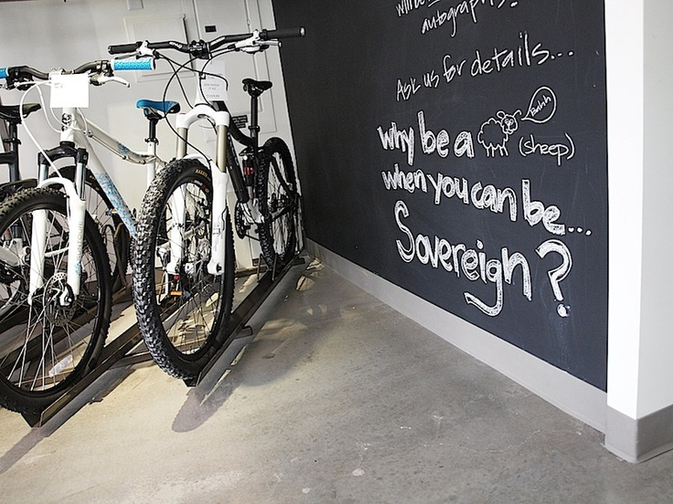 A contemporary bicycle shop; retail design by Hatch Interior Design Inc. in Kelowna, BC.  Interactive chalk board wall.