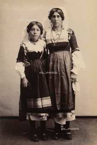 Woman and little girl in traditional costume from Calabria