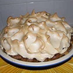 The filling for this pie is a thick and creamy custard studded with raisins. There's sour cream, sugar, nutmeg, eggs, lemon juice and a bit of cornstarch in this filling. Once it's cooked and stirred until thick, it's poured into a prepared pie shell. The pie is then topped with a lovely brown sugar meringue.