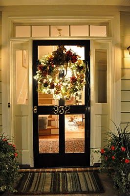 From the transom, the wreath, and the screen door, to the plants, the welcome mat, and the light inside; this is what I call a welcoming enterance.
