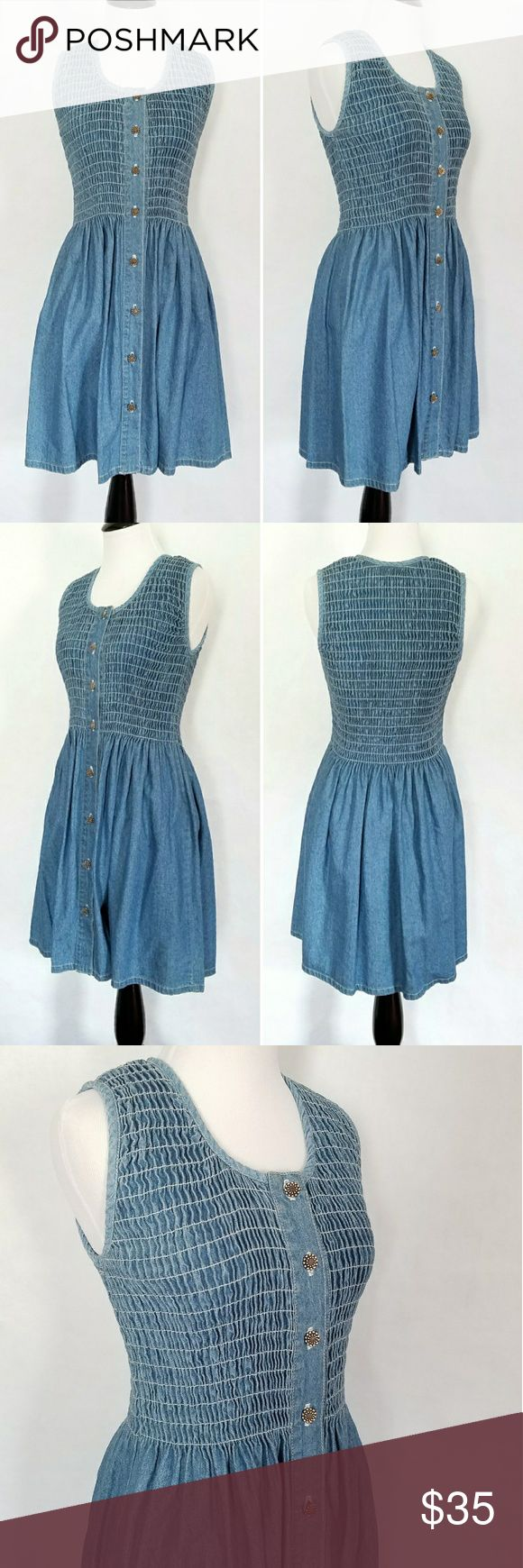 Denim Fit and Flare Dress Beautiful denim fit and flare dress with cute front silver button closure and smocked top.  100% cotton. Dresses Midi