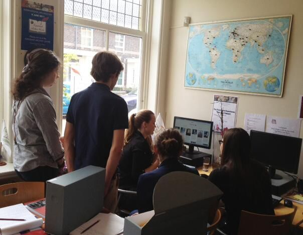 Students from Gymnasium Novum, Voorburg - Cid, Ingemarie, Rosanna and Karina - pictured here with our volunteer Jackie giving them an overview of her social media work.