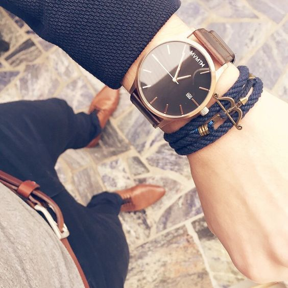 Drak Blue Bracelet styled with a Rose Gold Watch gives it a stylsih look