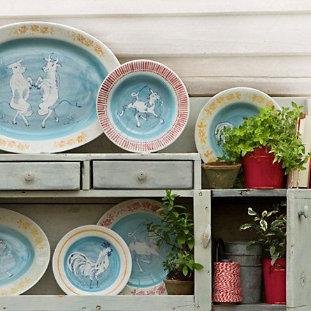 Farmhouse Dinnerware- not usual color for rooster. Cool