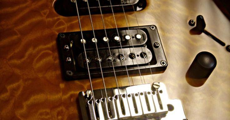 Como usar um voltímetro digital para checar se um captador está com defeito. Captadores de guitarra são feitos de um enrolamento de fio que envolvem seis ou mais pólos magnéticos. Seus estilos variam de acordo com o fabricante, mas os dois tipos básicos são simples e duplo. Você pode usar um voltímetro digital, ou multímetro, para testar se captadores apresentam dois defeitos elétricos comuns: um curto-circuito ou uma ...